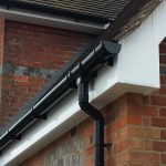 white-plain-soffits-fascia-and-black-deep-round-guttering